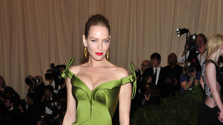 "Uma Thurman attends The Metropolitan Museum of Art's Costume Institute benefit celebrating ""PUNK: Chaos to Couture"" on Monday May 6, 2013 in New York. (Photo by Charles Sykes/Invision/AP)"