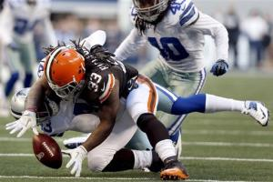 Cowboys beat Browns 23-20 in wild OT finish