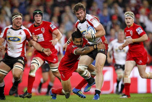 Queensland Reds centre Digby Ioane tackles Golden Lions centre Jaco Taute (C) during their Super 15 rugby union match at Suncorp Stadium in Brisbane on May 19, 2012.  IMAGE STRICTLY RESTRICTED TO EDIT
