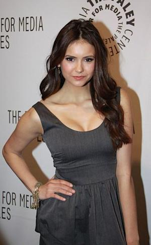 This writer felt Nina Dobrev's green frock was a fashion miss.