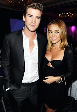 Miley Cyrus Flashes Cleavage on First Red Carpet With Liam Hemsworth Post-Engagement
