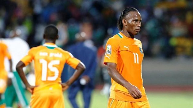 Ivory Coast's Didier Drogba leaves the pitch after losing their African Cup of Nations quarter-final (Reuters)