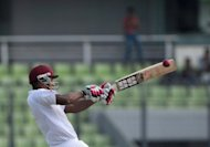 Kieran Powell plays a stroke for West Indies against Bangladesh in Dhaka on Tuesday. Powell notched 117 to help the West Indies to an imposing 361-4 at close on the opening day after Darren Sammy won the toss and opted to bat