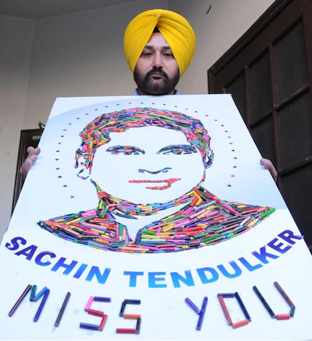 Artist H S Gill with a collage of master blaster Sachin Tendulkar as the cricket legend bid adieu to international cricket after his 200th Test at Mumbai's Wankhede stadium, in Amritsar on Nov.16,