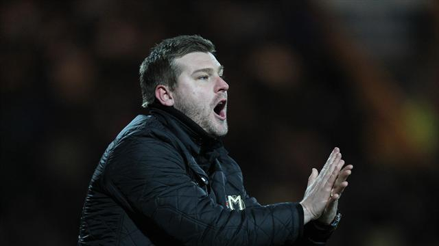 League One - MK Dons held by 10-man Swindon