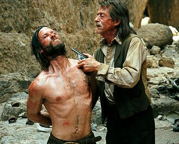 Guy Pearce and John Hurt in First Look's The Proposition