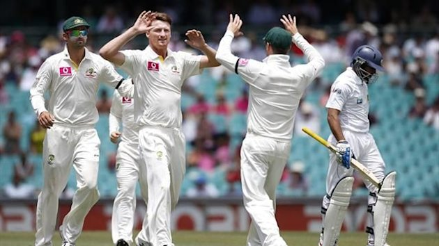 Australia's Jackson Bird is after dismising Sri Lanka's Tillakaratne Dilshan (R) on the first day of the third Test at the SCG (Reuters)