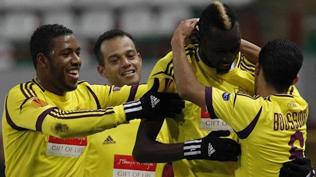 Anzhi Makhachkala's Lacina Traore (2nd R) celebrates with teammates after he scored against Liverpool