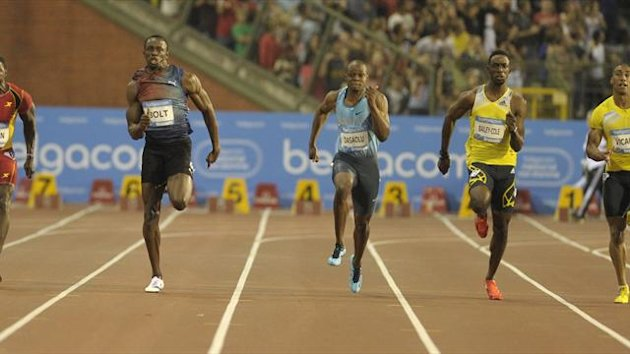 Usain Bolt of Jamaica (2ndL) runs on his way to win the men's 100 metres during the IAAF Diamond League athletics meeting, also known as Memorial Van Damme, in Brussels September 6, 2013 (Reuters)