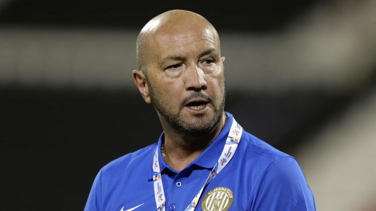 Al-Jazira UAE head coach Walter Zenga of Italy reacts during their AFC Championship League soccer match against Qatar Al-Rayyan in Doha