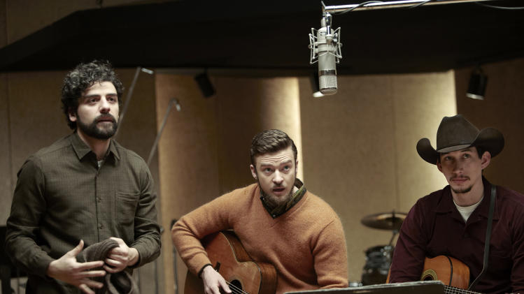 "FILE - This file film image released by CBS FIlms shows, from left, Oscar Isaac, Justin Timberlake and Adam Driver in a scene from ""Inside Llewyn Davis."" In the Coen brothers film, Timberlake plays a supporting role as a cheery, sweater-wearing 1960s folk musician. But he also collaborated with producer T Bone Burnett on the movie's memorable period songs and helped shape the film's most unforgettable and comic tune, ""Please Mr. Kennedy."" (AP Photo/CBS FIlms, Alison Rosa, File)"