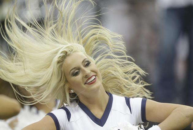 The Houston Texans cheerleaders perform during halftime of an NFL football game Sunday, Sept. 7, 2014, in Houston. (AP Photo/Patric Schneider)