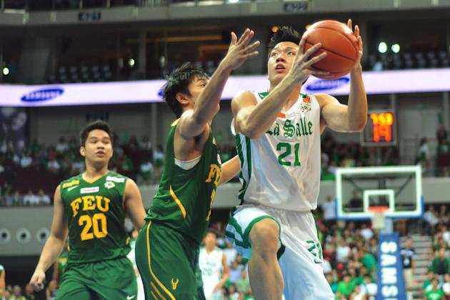 Jeron Teng drives to the hole against Terrence Romeo. (NPPA Images)