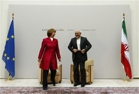European Union foreign policy chief Catherine Ashton (L) leaves with Iranian Foreign Minister Mohammad Javad Zarif after a photo opportunity before the start of two days of closed-door nuclear talks at the United Nations European headquarters in Geneva November 7, 2013. REUTERS/Denis Balibouse