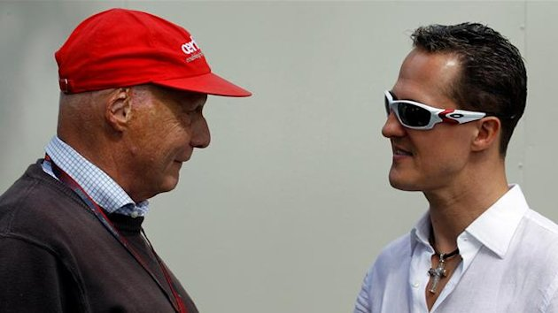 Mercedes Formula One driver Michael Schumacher (R) of Germany speaks with former F1 world champion Niki Lauda at Albert Park race track for the Australian F1 Grand Prix in Melbourne, March 27, 2010