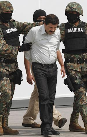 "Joaquin ""El Chapo"" Guzman is escorted to …"