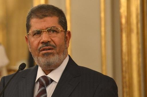 File photo of Egypt's then president Mohamed Morsi, taken during a visit to Rome on September 14, 2012