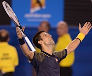 Serbia's Novak Djokovic celebrates after defeating Andy Murray to win the Australian Open on January 27, 2013. He has set his sights on completing the elusive career Grand Slam at this year's French Open after confirming his mastery of men's tennis in Melbourne