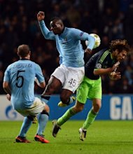 Mario Balotelli (centre) collides with Daley Blind (right) during the Champions League match between Manchester City and Ajax at The Etihad Stadium last week. Cesare Prandelli could help end Balotelli's frustrations by partnering him with AC Milan sensation Stephan El Shaarawy as Italy test their World Cup credentials against France