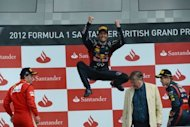 Red Bull Racing's Australian driver Mark Webber celebrates on the podium at the Silverstone circuit on July 8 during the British Formula One Grand Prix. Australian Mark Webber on Tuesday ended speculation about his future by signing a new one-year contract with Red Bull Racing for 2013