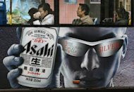 Asahi Beer ad is seen here displayed on a bus in Shanghai, China. Japan's Asahi Group Holdings has decided to buy Independent Liquor of New Zealand for about 100 billion yen ($1.3 billion) as the beverage giant expands in Asia and Oceania, according to a report