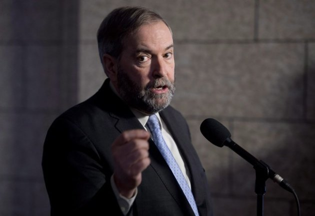NDP Leader Tom Mulcair speaks with the media following caucus in Ottawa on March 25, 2015. Tom Mulcair says an NDP government would take tax benefits from those who need them least and give them to those who need them most. The NDP leader is promising to scrap a tax loophole enjoyed by corporate executives on stock options, worth more than $700 million each year. THE CANADIAN PRESS/Adrian Wyld