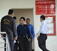 Officials leave the mortuary room after identifying the body of an Indian gang-rape victim from New Delhi who died overnight, at Singapore General Hospital, on December 29, 2012. The victim, 23, died overnight after suffering severe organ failure, the hospital treating her said, in a case that sparked widespread street protests over violence against women.