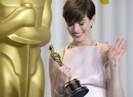 "Anne Hathaway with her Supporting Actress Oscar for ""Les Miserables"""