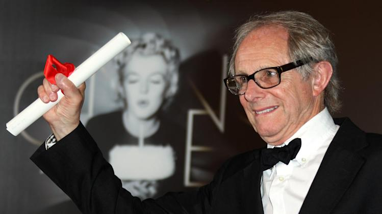 Ken Loach poses for photographers with the Jury's Prize for The Angels' Share during a photo call at the 65th international film festival, in Cannes, southern France, Sunday, May 27, 2012. (AP Photo/Joel Ryan)