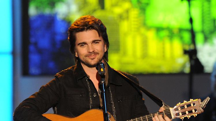"Juanes performs ""Sampa"" at the 2012 Latin Recording Academy Person of the Year Tribute to Caetano Veloso at the MGM Grand Garden Arena on Wednesday, Nov. 14, 2012, in Las Vegas. (Photo by Powers Imagery/Invision/AP)"