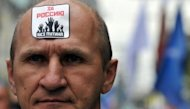 A man takes part an anti-Putin protest in Moscow. The sticker reads: For Russia without Putin!