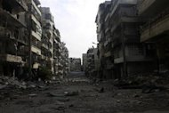 A damaged street is pictured in the Salah al-Din neighbourhood in central Aleppo December 25, 2013. REUTERS/Houssam Kattan