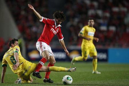 Benfica's Pablo Aimar is tackled by FC Pacos de Ferreira's Andres Leao during their Portuguese Premier League soccer match at Luz stadium in Lisbon