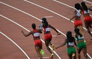 Sprinters are seen competing in the women's 4x100m relay heats at the athletics event during the London 2012 Olympic Games, on August 9. The final is taking place on Friday, with the USA team leading the qualifying times