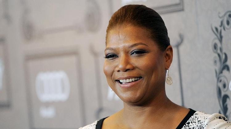"FILE - This Oct. 5, 2012 file photo shows Queen Latifah at Variety's 4th annual Power of Women event in Beverly Hills, Calif. Latifah's new talk show, ""The Queen Latifah Show"" comes out from Sony Pictures Television in September 2013. (Photo by Chris Pizzello/Invision/AP, file)"