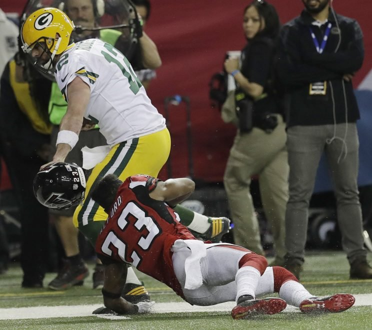 Aaron Rodgers got a 15-yard penalty for grabbing Robert Alford's face mask. (AP)