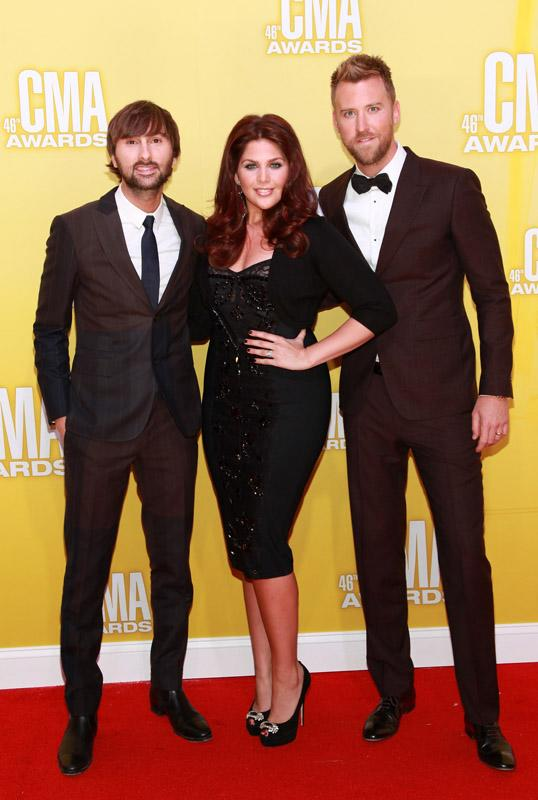Double CMA nominees Lady Antebellum were back in black! The classy trio consisting of (L-R) Charles Kelley, Hillary Scott, and Dave Haywood were also among the night's performers. (11/1/2012)