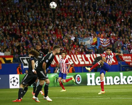 Atletico Madrid's Costa tries a shot during their Champions League semi-final first leg soccer match against Chelsea at Vicente Celderon Stadium in Madrid