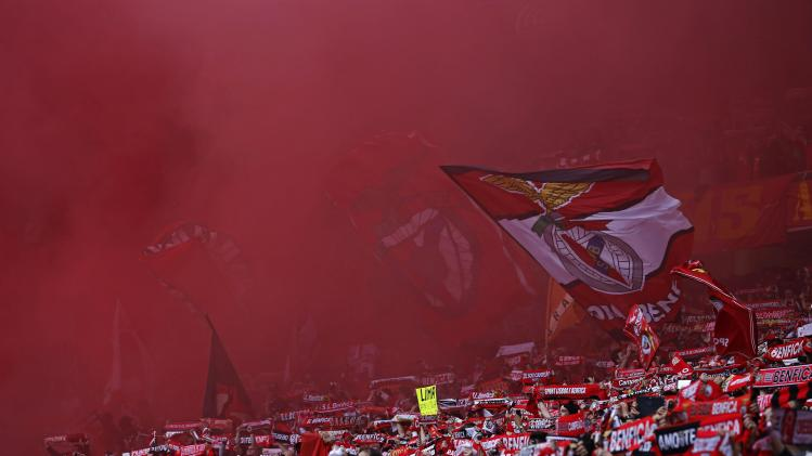 Benfica's supporters wave flags before their Portuguese Premier League soccer match against Olhanense held at Luz stadium in Lisbon