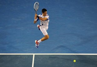 Photo 1 - Novak Djokovic Of Serbia Plays AFP/Getty Images