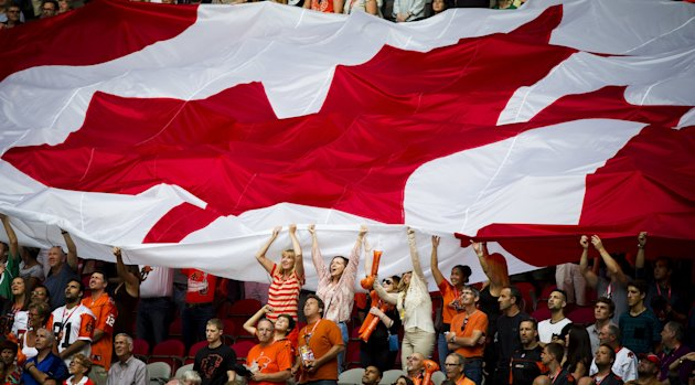 A Canadian flag is passed along fans during the B.C Lions game July 10, 2015. (Reuters)