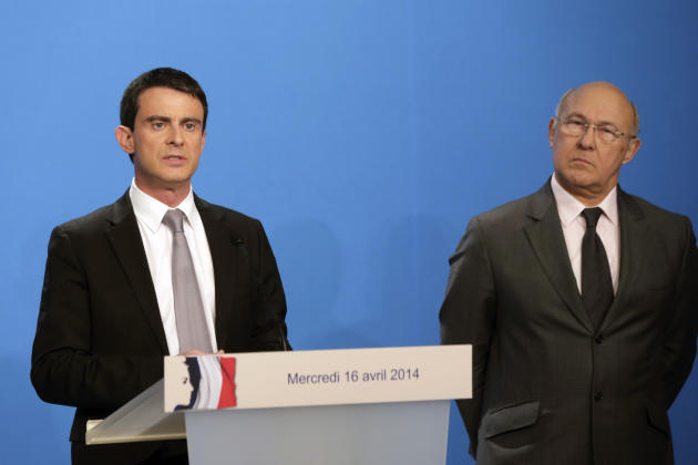 French Prime Minister Manuel Valls delivers a statement while Finance minister Michel Sapin, right, after the weekly cabinet meeting at the Elysee Palace in Paris, Wednesday, April 16, 2014. Valls pro