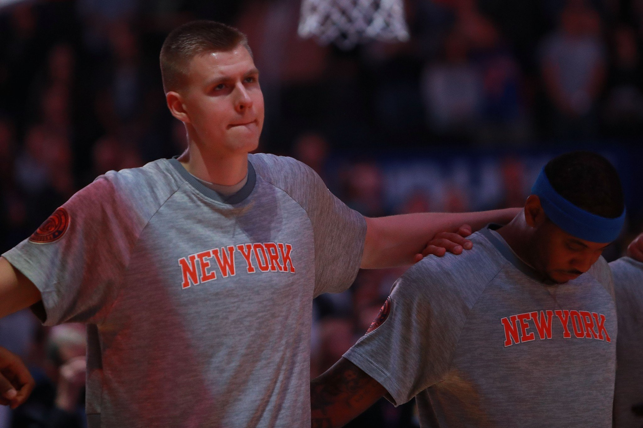 Carmelo Anthony (right) and Kristaps Porzingis of the New York Knicks stand together during the national anthem prior to a Oct. 15, 2016, preseason game. (Getty Images)