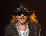 French police arrested a woman in connection with the theft of gold necklaces and diamonds worth around $200,000 (160,000 euros) from Guns N' Roses frontman Axl Rose, seen here in 2011, at a concert in Paris