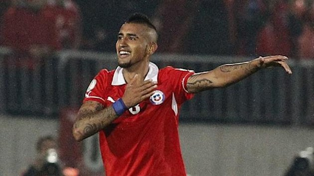 Chile's Arturo Vidal celebrates after scoring his team's third goal against Venezuela (Reuters)