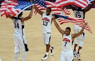 (From L) Anthony Davis, Chris Paul, Russell Westbrook and James Harden of the basketball Team USA celebrate after winning their London 2012 Olympic Games gold medal game against Spain at the North Greenwich Arena in London, on August 12. USA won 107-100
