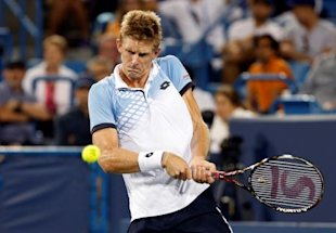 Cincinnati, OH, USA; Kevin Anderson (RSA) returns a shot against Roger Federer (not pictured) on day six during the Western and Southern Open tennis tournament at Linder Family Tennis Center on Aug 20, 2015.  Aaron Doster-USA TODAY Sports