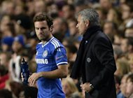 Chelsea's manager Jose Mourinho (R) prepares to bring on substitute Juan Mata during their Champions League soccer match against Basel at Stamford Bridge in London September 18, 2013. REUTERS/Dylan Martinez