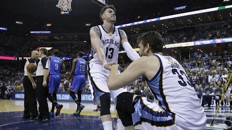 Memphis Grizzlies forward Mike Miller (13) helps Marc Gasol (33) up off the court in the second half of Game 3 of an opening-round NBA basketball playoff series against the Oklahoma City Thunder on Thursday, April 24, 2014, in Memphis, Tenn. The Grizzlies won 98-95 in overtime