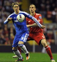 File picture shows Liverpool's Daniel Agger challenging Spanish striker Fernando Torres. Chelsea's Spanish forward Fernando Torres (L) vies with Liverpool's Danish defender Daniel Agger during a Premier League football match at Anfield in May. Liverpool won that match 4-1